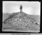 Man on clamshell pile (Rock Island County scenery)