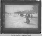 [Boys playing on frozen river or lake]