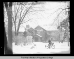 [Hauberg home, exterior with snow and newspaper carrier]