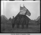 Four soldiers in front of flags, Illinois National Guard