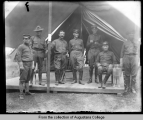 Illinois National Guard, men posed in front of tent