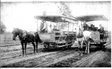 Two horse drawn trolley cars