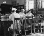 Cottage Hospital student nurses in the school library
