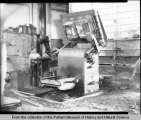 Man standing by a machine at Bettendorf Company
