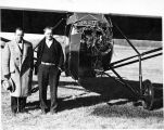 "Kenneth "" Beans "" Hunter (R) and Lawrence Pedigo (L) standing by plane which lost engine"