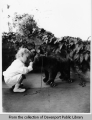 [Little boy with bear pull toy]